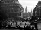 Edge of Trafalgar Square w/ two lions doubledecker bus BG HA WS Piccadilly Circus w/ double deckerbuses traffic people 'Guinness is good for you'...