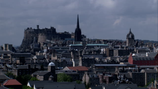 Edinburgh Castle and cathedral spires overlook Edinburgh Scotland. Available in HD.