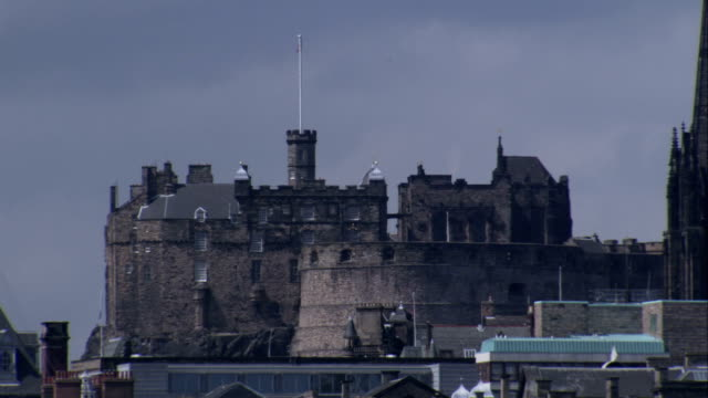 Edinburgh Castle dominates the cities skyline. Available in HD.