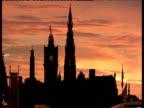 Edinburgh Cathedral silhouette against orange sky at sunset