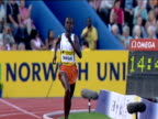 Edith Masai checks her time on wrist watch as she wins Women's 5000m 2004 Crystal Palace Athletics Grand Prix London