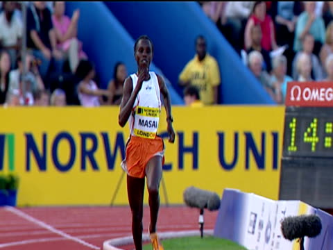 Edith Masai checks time ran on her watch after winning Women's 5000m 2004 Crystal Palace Athletics Grand Prix London
