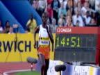 Edith Masai wins Women's 5000m checks her time on stopwatch 2004 Crystal Palace Athletics Grand Prix London
