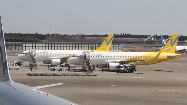 edium views of signage for Vanilla Air aircraft parked at Terminal 3 of Narita Airport in Narita Japan on Wednesday March 25 Two Vanilla aircrafts...