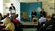 Education Secretary speech on Free Schools ENGLAND London INT Michael Gove MP listening / General views of audience listening then applauding SOT /...