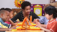 MS PAN Educator Teaching Children How to Use Computers in Daycare / Richmond, Virginia, USA