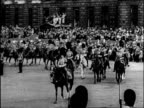 Edward VIII marching in funeral procession for King George V / Edward in uniform leading guards on horseback he wears the bearskin headpiece /...