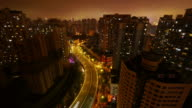 Eerie night time lapse of Residential area-static, apartment buildings, street, traffic, night, city lights, Shanghai, China