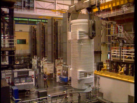 Effects of ending fuel reprocessing abroad LIB Cumbria Sellafield Container being raised from water tank in THORP plant Monitors in control room...