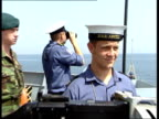 Effects on oil ITN GULF AT SEA INT Naval officer communicating with navigator thru mouthpiece in gallery of ship EXT AIR VIEW HMS Argyll along thru...