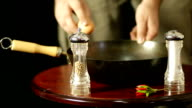 Egg falling into pan