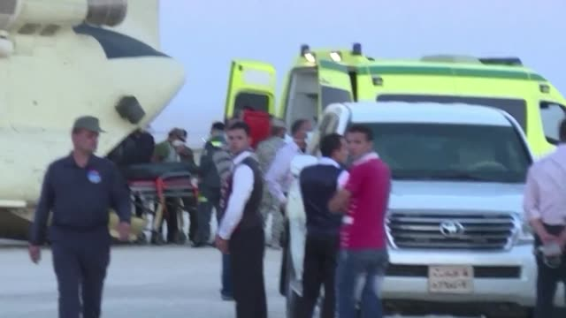 Egyptian paramedics Saturday loaded the corpses of victims from a Russian plane crash in the Sinai Peninsula into a military aircraft at Kabret...