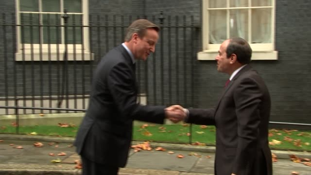 Egyptian President Downing Street arrival ENGLAND London Downing Street EXT Abdel Fatah alSisi along and shaking hands with David Cameron MP then...