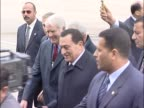 Egyptian president Hosni Mubarak arrives at Heathrow for start of London visit Walks across tarmac in vip area under an umbrella