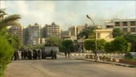 Egyptian soldiers on foot and in tanks take fire on proMorsi protest camp