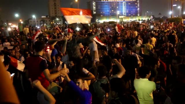 Egyptians celebrate at Tahrir Square after Egypt's national soccer team qualified for FIFA World Cup 2018 by defeating Congo 21 on October 08 2017 in...