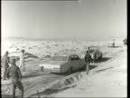 day 7 ***ALSO EGYPT Suez Canal TS Israeli soldier into water of Suez Canal for first time in years CS Stoops and splashes pan to more on rocks pull...