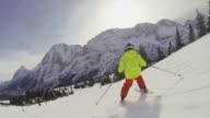 Ehrwalder Alm ski area, boy skiing on piste