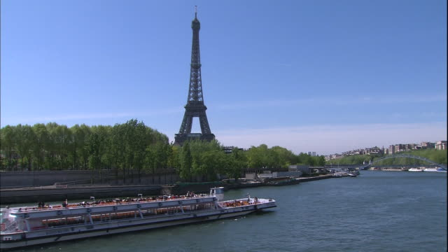 Eiffel Tower and the Seine Tour boat sailing Long Shot