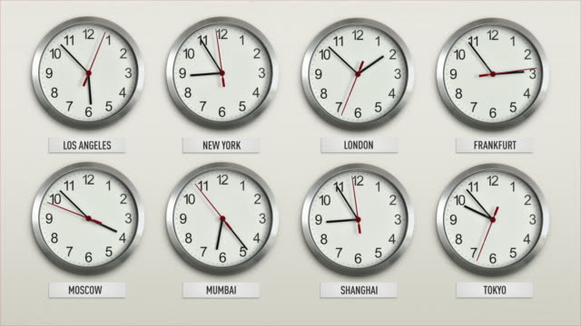 Eight clocks labeled with financial cities from around the globe show there local times relative to the other clocks on the wall