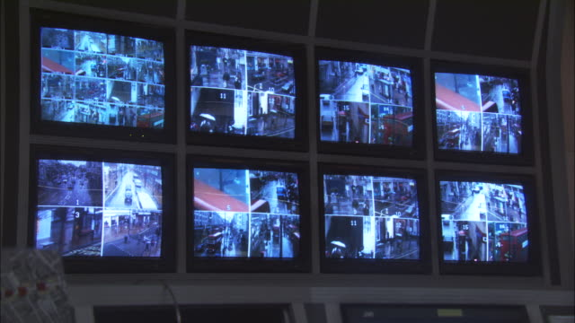 MS, Eight security surveillance monitors with view of London streets, London, England