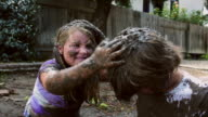 Eight year old twins mud fight - Closer shot - mud in the hair