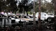 Eighty cars are destroyed or badly damaged in a devastating fire at Sydneys Olympic Park which investigators on Monday say was likely started by a...