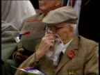 Eighty years on ITN CBV Soldier as plays 'The Last Post' on bugle PAN LR to show crowd CS SIDE Veteran wiping eyes with handkerchief CMS Veteran...