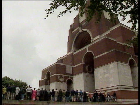 Eighty years on ITN Somme LS Church as church bell rings SOT with rows of graves headed with white tombstones in f/g MS Inscription on tombstone of...