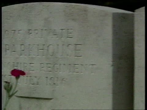 Eighty years on ITN FRANCE Somme LS Church with rows of tombstones in f/g MS Inscriptions on tombstones PAN TLMS Rows of tombstones LA LMS Somme...