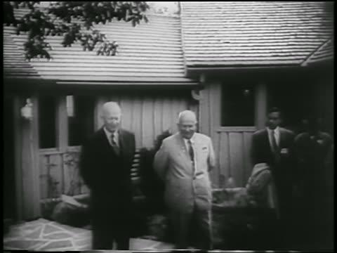 Eisenhower Khrushchev talking in front of house at Camp David / Maryland / newsreel