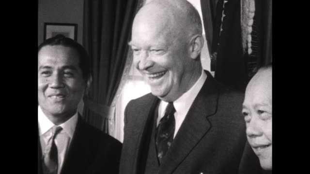 Eisenhower meets with Macapagal and another man in the Oval Office Macapagal give a statement to the press