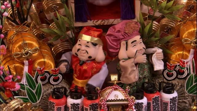 Elaborate lucky rakes with Seven Deities of Good Fortune at Ohtori Shrine Medium Shot