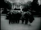 Elderly Albert Einstein walking with entourage Albert Einstein on January 01 1955