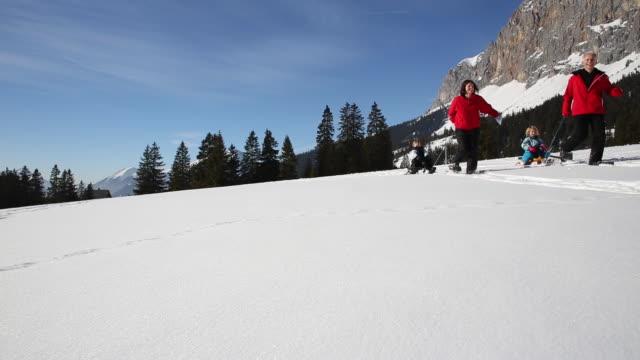 Elderly couple cross-country skiing