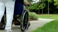 Elderly Man in Wheelchair with Nurse