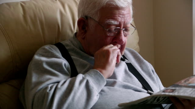 Elderly Man Relaxing with his Newspaper