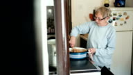 Elderly woman cooking