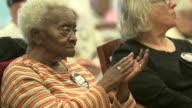 Elderly woman dances in her seat retirement center