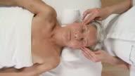 HD CRANE: Elderly Woman Enjoying Facial Massage