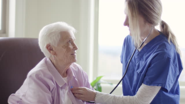 Elderly woman getting care in a home healthcare setting