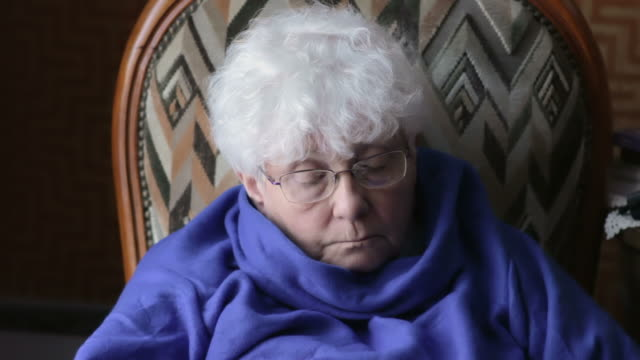 Elderly woman looking at electronic device
