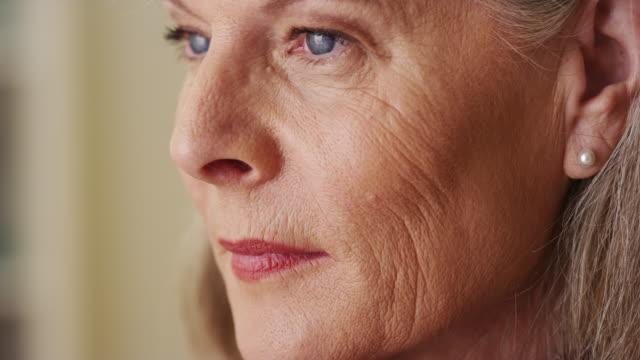 Elderly woman looking away closeup