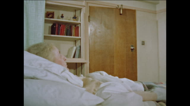 Elderly woman sick in bed