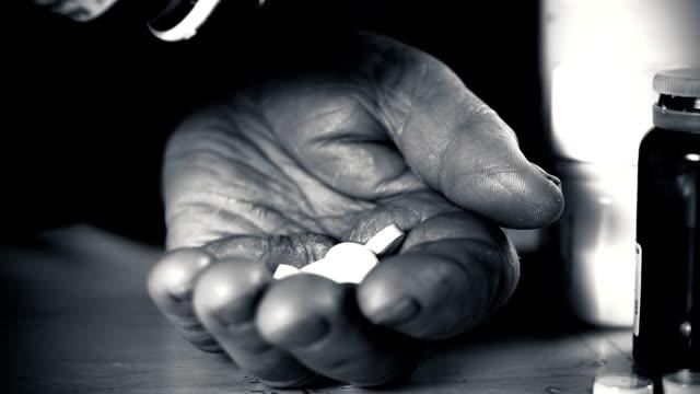 HD SLOW MOTION: Elderly Woman Taking Many Pills