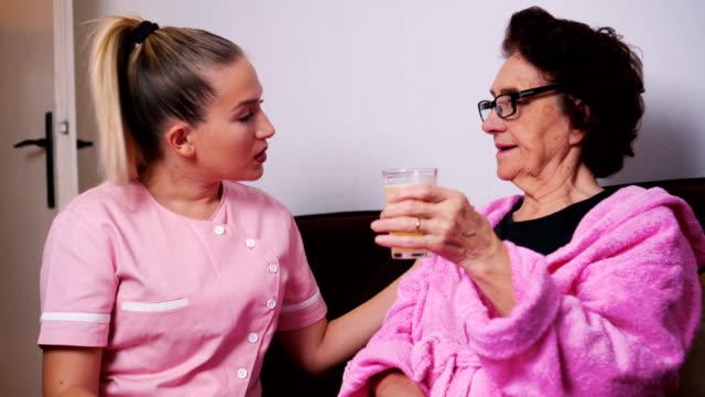 Elderly woman with geriatric nurse