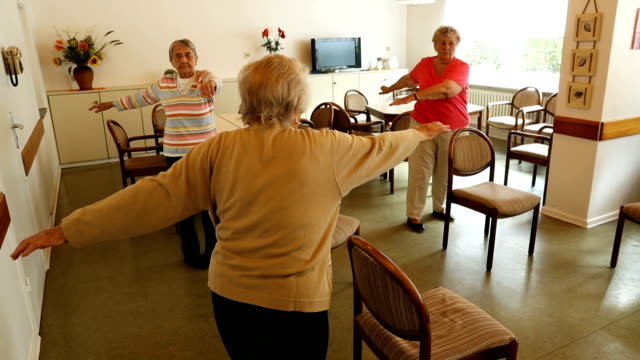Elderly women lift their arms during an hourlong session of physical exercise at the Mireille Mathieu senior citizens' center on September 20 2017 in...