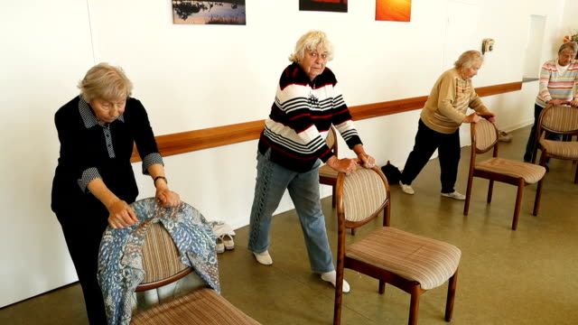 Elderly women move their legs side to side during an hourlong session of physical exercise at the Mireille Mathieu senior citizens' center on...