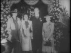 Eleanor Roosevelt walks down stairs gets off plane hugs and kisses daughter Anna Boettiger and son James Roosevelt and soninlaw James Boettiger /...