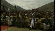 Election campaigning continues / security AFGHANISTAN The Panjshir Valley EXT Snowcovered mountains PULL OUT men sat at election rally Meat on...